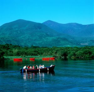 Boat in Lake with Mountains in background